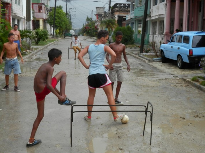 Streets are empty enough for children to play soccer in the middle of the day.