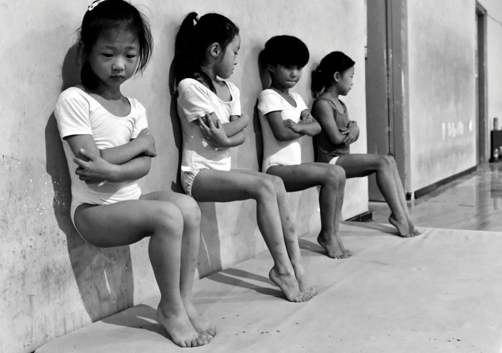 Vida Cotidiana, segundo premio. Cuatro estudiantes de la escuela de gimnasia en Xuzhou, China.Tiejun Wang, REUTERS