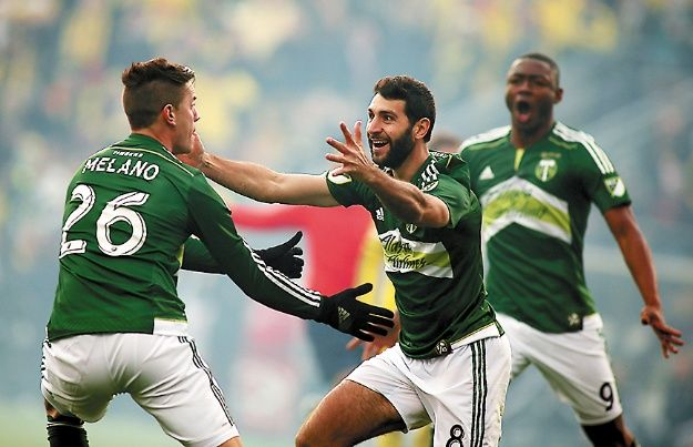 MLS: MLS Cup Final-Portland Timbers at Columbus Crew - Dec 6, 2015; Columbus, OH, USA; Portland Timbers midfielder Diego Valeri (8) celebrates with midfielder George Fochive (26) after scoring a goal against the Columbus Crew during the first half in the 2015 MLS Cup championship game at MAPFRE Stadium. Mandatory Credit: Trevor Ruszkowksi-USA TODAY Sports
