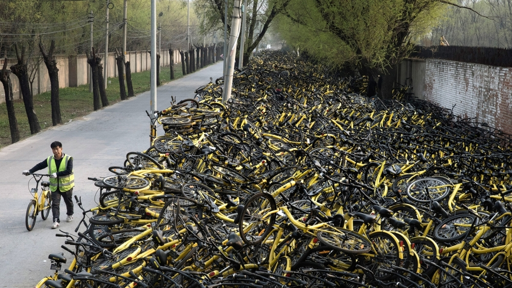 Beijing's Bike Share Boom Creates Refuge for Battered Bicycles