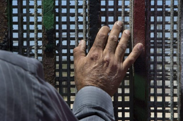 Pastor Guillermo Navarrete of the Methodist Church of Mexico stands at the border fence at Friendship Park during the weekly meeting of the Border Church in Tijuana, Mexico, on May 22, 2017. The binational service is conducted simultaneously on both sides of the border fence in English and Spanish. Photo by Griselda San Martin. Used with permission.
