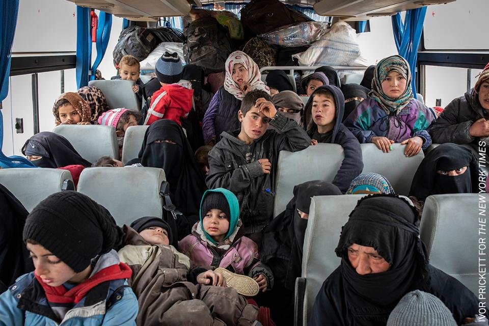 Mujeres y niños refugiados en Siria
